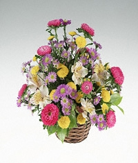 Basket of mixed bright flowers