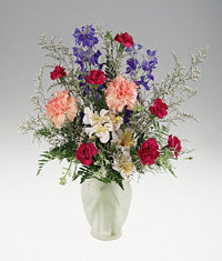 A frosted vase of mixed flowers