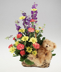 Flowers with plush bear