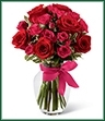 The Love-Struck Rose Bouquet uses a touch of Cupid's magic this Valentine's Day to usher in romance and sweet love.  Bright red roses and hot pink spray roses are artfully arranged amongst lush greens in a clear glass vase tied with a taffeta bi-colored ribbon to create a bouquet of passion and beauty.