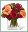 The Deep Emotions Rose Bouquet showers your special recipient with affection and admiration in sun-crushed hues. Deep fuchsia roses and spray roses share the spotlight with bright orange roses, green hypericum berries and lily grass blades gorgeously arranged in a clear glass vase. Fresh and eye-catching with extraordinary color, this bouquet will evoke warm feelings with its undeniable charm.