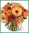 The Natural Elegance Bouquet ushers in the beauty and bounty of the Autumn season with abundant color mimicking the grandeur of this special time of year.  Lush Leonidas Roses, orange spray roses, golden gerbera daisies, and peach Peruvian Lilies are perfectly arranged in a clear glass bubble bowl vase to create a striking sentiment of gratitude and warmth.