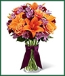 The Harvest Heartstrings Bouquet is a fresh burst of color and autumn light that will surround your special recipient with beauty. Exquisite Cherry Brandy Roses are brought together with purple Peruvian Lilies, orange Asiatic Lilies and burgundy mini carnations accented with lush greens and arranged in a classic clear glass vase. Highlighted by a deep eggplant satin ribbon tied around the neck of the vase, this bouquet is an arrangement that speaks to the heart of the fall season.