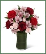 The Love in Bloom Bouquet is the perfect expression of sweet affection and adoration. Rich red roses, burgundy carnations, pink Peruvian lilies, pink mini carnations and lush greens are gorgeously arranged in a clear glass vase to convey your most heartfelt emotions.