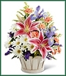 The Wondrous Nature Bouquet is bountifully bedecked with a dazzling display of color and beauty. Stargazer lilies stretch their fuchsia petals out amongst an arrangement of blue iris, white traditional daisies, orange mini carnations, purple statice, and yellow solidago in a round whitewash handled basket, creating a delightful bouquet your special recipient will adore.